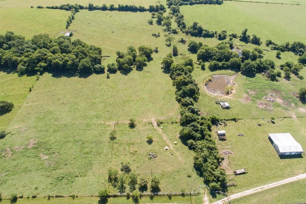 This lovely 12.74 acre tract is centrally located in the desirable Whitehall area off of CR-316 on CR 316-A between Montgomery and College Station. This property fronts a paved road and is fully fenced and cross fenced.  A water well and set electrical pole makes access to utilities convenient. Plenty of sites to build and/or add a pond with rolling sloped terrain to create amazing views.  Great for horses or cattle.  Peaceful country living with a very short commute to amenities. Easy access to Houston, Conroe or College Station with the the Aggie Highway coming a few miles from this property. The property is cleared and currently holds an agricultural exemption resulting in very low taxes.  The adjoining 14 acre and 17.27 acre tracts are also available. Ask listing agent for details.