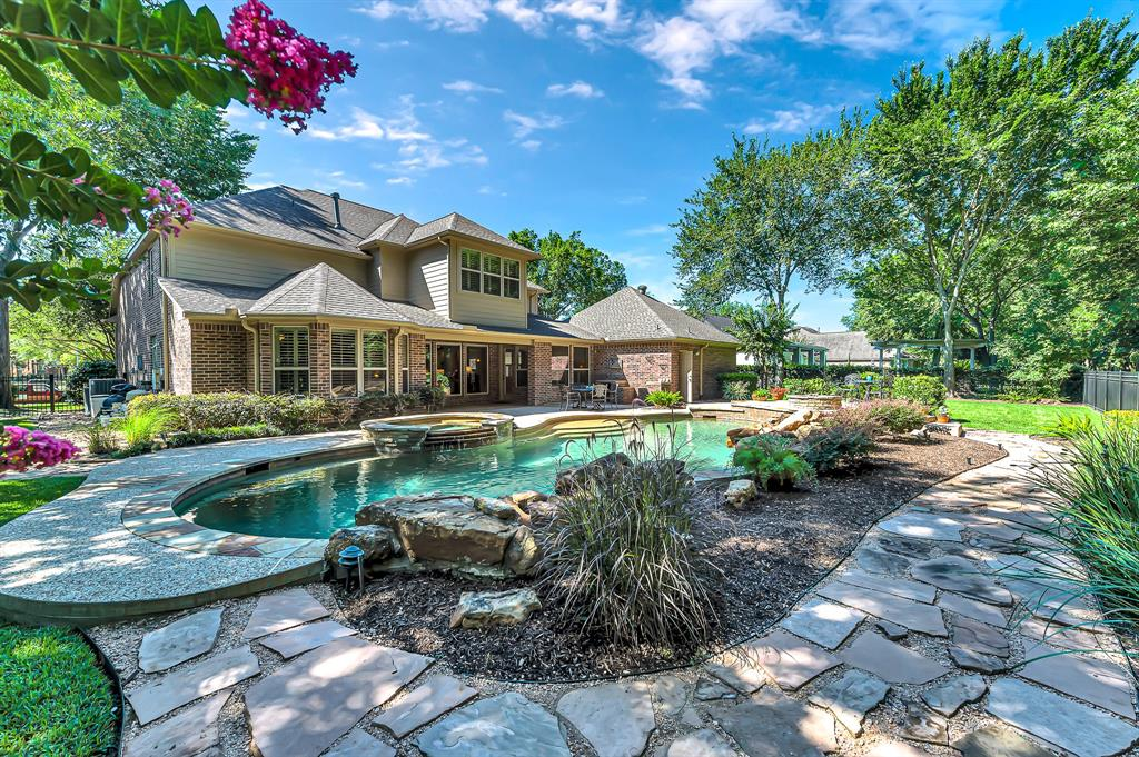 """Unique opportunity to own this executive David Powers home on spectacular 1/3 acre golf course lot in Seven Meadows! With views of hole #10 on Meadowbrook Farms Golf Course, this 4 bedroom home features a recent roof (2016), Trane HVACs (2017), water heaters (2018), pool pumps & filter (2020). Custom details include plantation shutters, built-ins, island kitchen, integrated indoor & outdoor Bose sound system, gated porte-cochere with add'l parking & double crown molding! Open concept first floor features panoramic outdoor views, expansive master suite, formal dining, study, breakfast & sun room. Game & media rooms with theater seating & dry bar, 3 bedrooms, 2 full baths, 10' homework desk & """"secret"""" bonus space complete the 2nd story. Step outside & enjoy the sparkling pool, spa, fire pit & waterfall, pool half bath & outdoor kitchen! Large green space & lush landscaping make the backyard a space you'll use all year. Zoned to Holland, Beckendorff, & Seven Lakes in acclaimed Katy ISD!"""