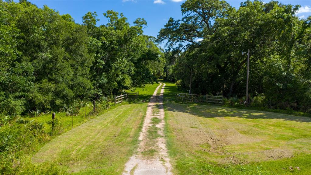 Remarkable opportunity to own your own ranch strategically located near the Texas Gulf Coast and only an hour away from Houston. This beautiful 96+/- acre ranch features highway 35 frontage and shares property lines with a portion of the San Bernard National Wildlife Refuge and water frontage on the Linnville Bayou. Home to excellent hunting with oversized bucks and a year round cattle lease, it also comes equip with a corral, chutes, gates and livestock feeders and troughs. Property also contains over 210 paper-shell pecan trees which can be harvested for profit. Ranch is ready for a homesite with utilities in place. Breathtaking views throughout with plenty of changes in scenery within the property. Don't miss out on this amazing opportunity to own your own Texas ranch.