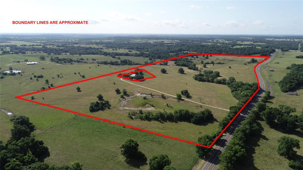 66+/- incredibly beautiful rolling acreage on FM 1774 in Anderson, TX! This is true rare find. This property has approximately 2643 ft of road frontage on FM 1774. It has elevations that range from 360 ft to 300 ft. Panoramic views and potentially a great parcel for dividing. Lots of places to build your dream home. Unrestricted use. Plenty of wildlife, fully fenced for cattle, and cross-fenced with working pens. Electricity comes in from the rear. It has 1 pond and 1 small seasonal creek that runs through portion of the property. Great foliage through out. This property has lots of potential and endless possibilities. Must see! Call listing agent for details.