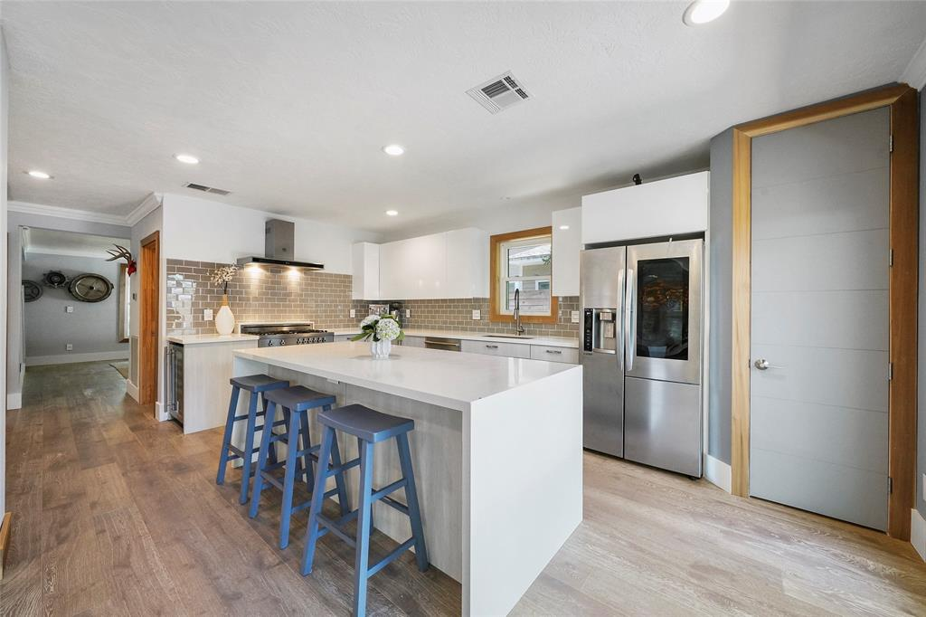 The beautiful Caesarstone countertops compliment the bright kitchen.