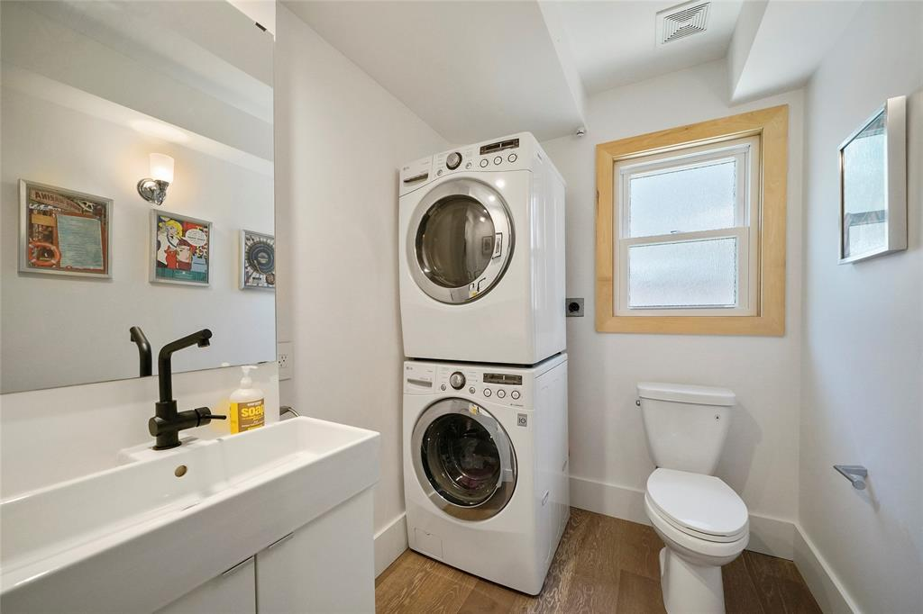 Spacious downstairs powder room can double up as a utility area.