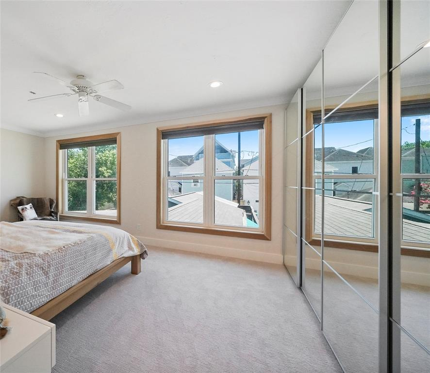 Entrance into master bedroom with large windows and greenery.