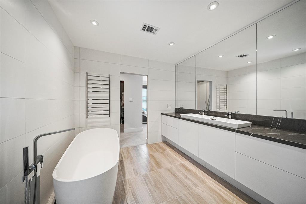 Beautiful fixtures and hardware compliment the sleek master bathroom.