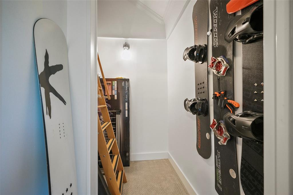 Guest room closet leads to a large carpeted storage space up the ladder. Could also be used as a kids den!