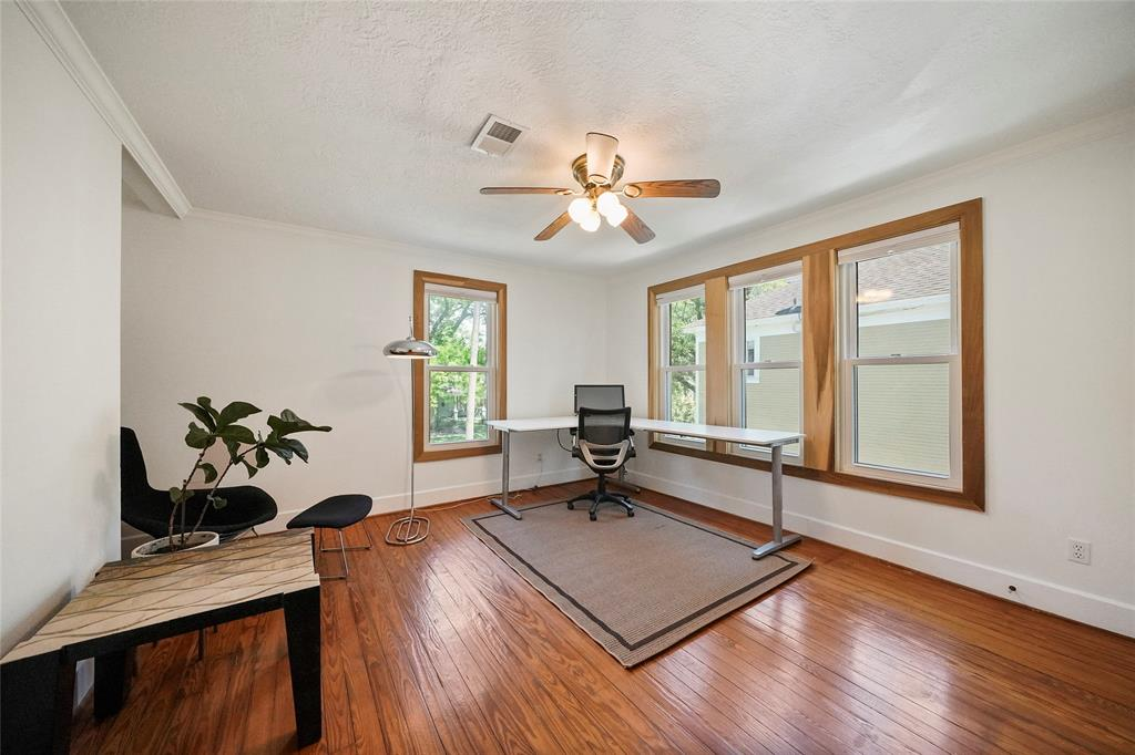 Third bedroom or study/playroom space is big enough to suit any needs. Full wall closet space next to the door. The original hardwood floors add to the 1920's character.