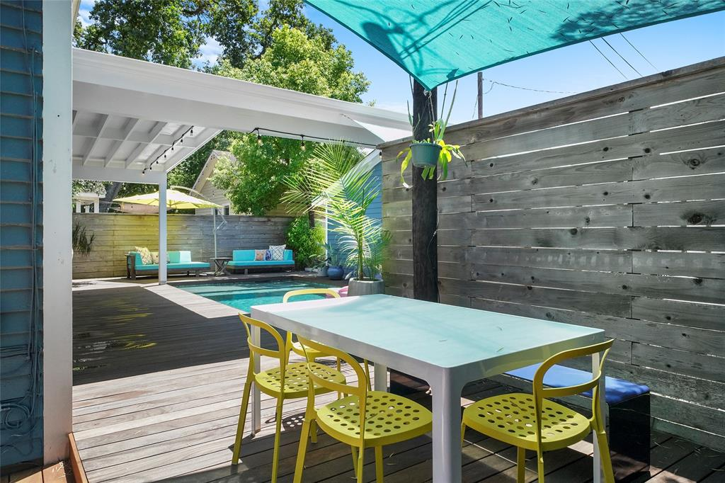 A view of the pool and outdoor lounge space is inviting and perfect for Houston summers.