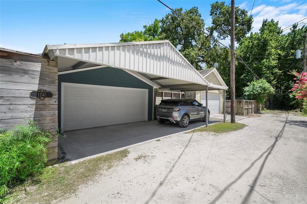 Back alley access to your double garage and extra parking with the carport.