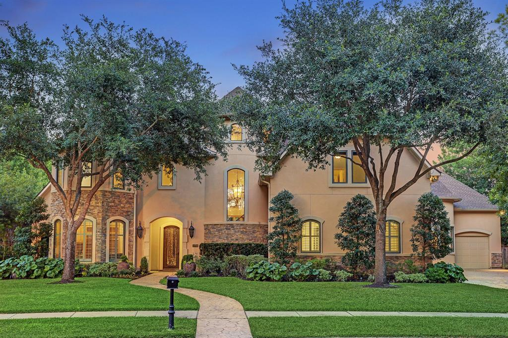 Tucked away in the Exclusive gated community of Cinco Ranch Bayou Woods, this showstopper Mediterranean home is picture-perfect & offers a resort-style luxurious lifestyle. Accentuated by 16' ceilings & impressive arched windows throughout, this 5 bed/4 bath/2 half bath property offers: Formal living, family room, formal dining, huge breakfast room, wet bar, chef's kitchen, formal study, mud room & planning room, 1st floor master suite, 4 huge upstairs bedrooms all w/ensuite bath, game room, huge walk-in closets, tropical pool & spa w/full outdoor kitchen, 3 car garage, abundant natural light & more. The master retreat is equipped w/doors leading to the pool/spa & outdoor sitting, stunning master bathroom w/huge tub & separate walk-in shower, & 2 massive closets. Enjoy expansive mature trees, bushes, and flowers in the totally private backyard. This home is a custom masterpiece & is zoned to the best KISD schools. New roof, New A/C Unit, No flooding. View the 3D tour & video!