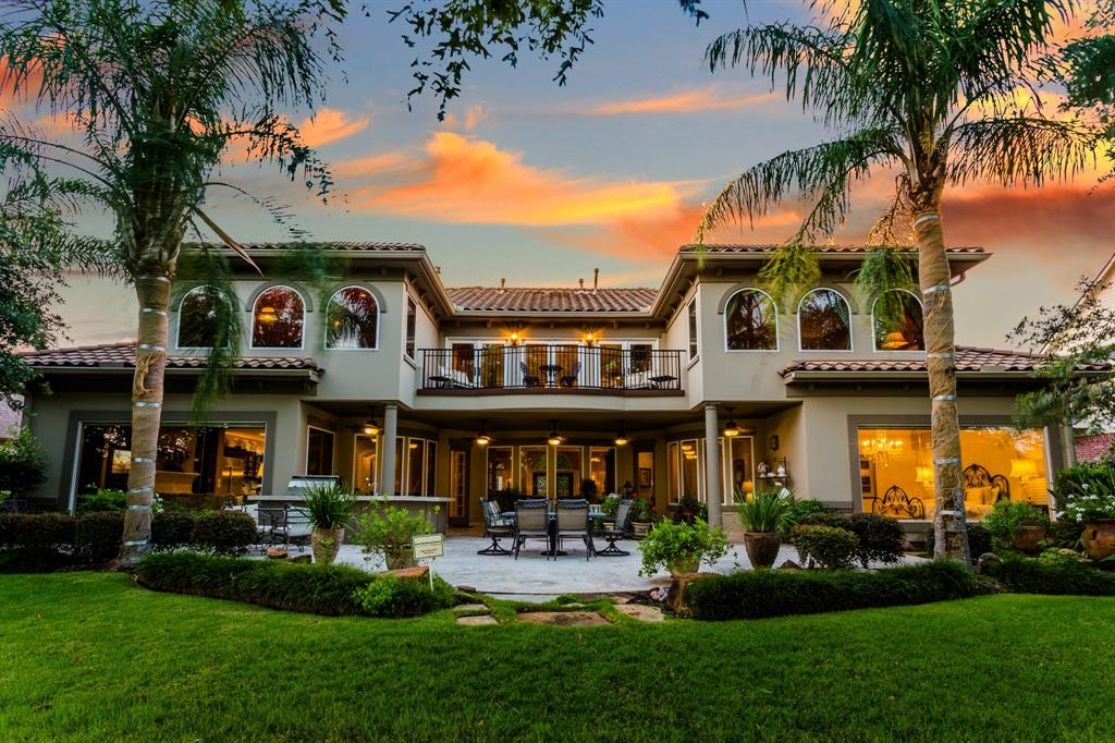 Resting beneath a tile roof, magnificence abounds in this Mediterranean-flavored showpiece on the 2nd fairway of the Fred Couples Signature Golf Course in the gated community of Royal Oaks Country Club. Architecturally stunning, it boasts a majestic rotunda ceiling, sweeping wrought iron balustrades, hand painted murals by Allan Rodewald & Jeff Szymanski, 20' ceilings, towering stone FP & enormity of windows imparting panoramic views of the golf course. Kitchen features SS appliances, SubZero refrigerator, butler's pantry, BKFT bar & wine grotto. 1st floor master suite has separate lounge area, FP, opulent bath & picturesque view of rear grounds. Guest suite w/ private entrance, secondary master suite on 2nd floor, 3 staircases, 2 terraces, 4 car garages & 3 fireplaces. Parklike setting & summer kitchen are immersed in unmatched beauty transforming exterior spaces into natural extension for peaceful living at its best. Outstanding!