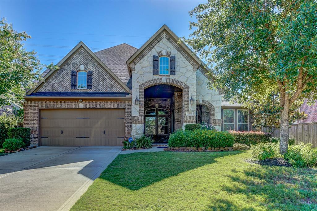 Find the home of your dreams in the master-planned community of Cinco Ranch Southwest. Backed up onto the community walking trails, this 4-bedroom, 3.5-bathroom property features wood flooring, an open living room, dining room with a coffered ceiling, a study room with French doors, a game room with tray ceilings, and a family room with a fireplace. Equipped with granite countertops, a mosaic backsplash, gas cooktop, breakfast bar, and pendant lighting, the stunning island kitchen will be a delight to any chef with an whole house osmosis system. Feel the stress melt away as you relax in the spa-like master suite, complete with a walk-in closet, dual vanities, a whirlpool tub, and separate shower. Built for outdoor entertaining and leisure, the beautifully landscaped backyard features a pool, a cabana with a wet bar, and a covered patio. Community comforts include clubhouses, pools, tennis courts, and more. Students attend schools in Katy ISD, including the Seven Lakes High School.