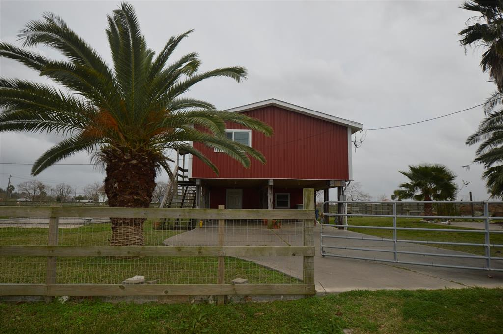 This is a unique find, adorable cottage on 2.71 Acres in Galveston!  This plot of land has an open concept cottage home, where you have Living room with wood burning/gas fireplace, kitchen, bedroom area, bath with jetted tub, stackable washer/dryer, stand up shower.  Deck off the back to watch over your land.  Outdoor sitting areas, with fire pit, and a barn.  You can have horses, goats, chickens .... make your own menagerie.  This little slice of heaven is fully fenced and ready for your imagination.