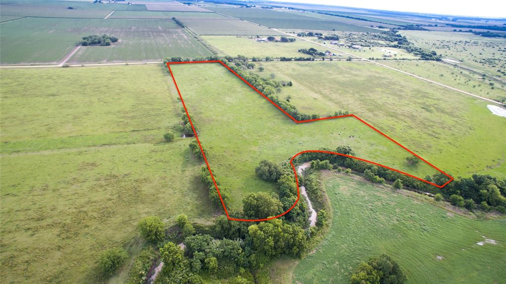 Acreage - A Great opportunity to build your country home on this cleared 12 acre tract, with a creek running through it. Electric fence around the property. Minutes from 59 or the Wharton County Fair Grounds.