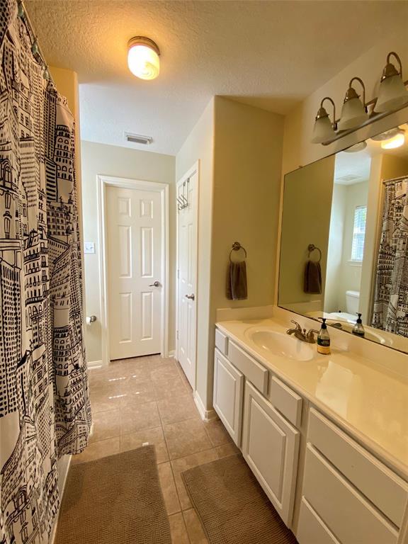 Bathroom adjoining two bedrooms.
