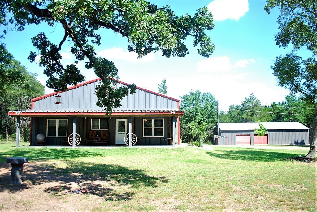 """Looking for your little chunk of """"Heaven"""" in the country?  Well here it is!!  This fantastic, immaculate,  nicely secluded 11.943 acre wooded parcel boasts a 40' x 50' metal Building built in 2017 w/1448 Sq. Ft. (per seller) of finished out living quarters. Offers a spacious living, kitchen & dining area, 2 bedrooms & 1 bath downstairs and a large loft area upstairs that is being used as a 3rd bedroom with sitting area. Nicely finished out with Granite, laminate wood flooring & carpet in the bedrooms.  Lots of storage for all your equipment. There is an additional 1800 Sq. Ft. Metal building built in 2019! The land has been selectively cleared around the improvements & the remainder has been left virgin for the abundance of wildlife that call this area home.  Located down an owned Lane provides plenty of privacy. This one will be love at first sight. Location on Weishuhn Rd, off Zimmerscheidt Road in the highly sought after northern Colorado County area."""