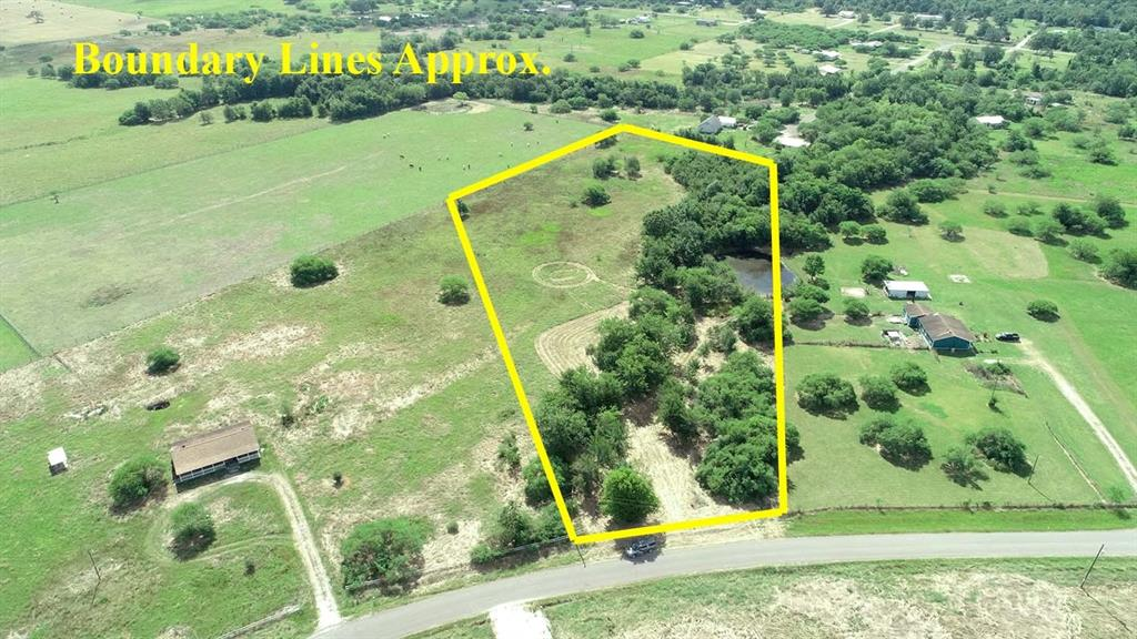 Great unrestricted 5.179 acre tract right outside of Bedias. Being partially wooded with a pond and paved road frontage makes this tract appropriate for a homesite or a weekend get-a-way! We do have a survey on file.  Pond is shared with neighbor. This is a wonderful opportunity, call today for a tour! Seller will be leaving some fencing materials for the buyer.