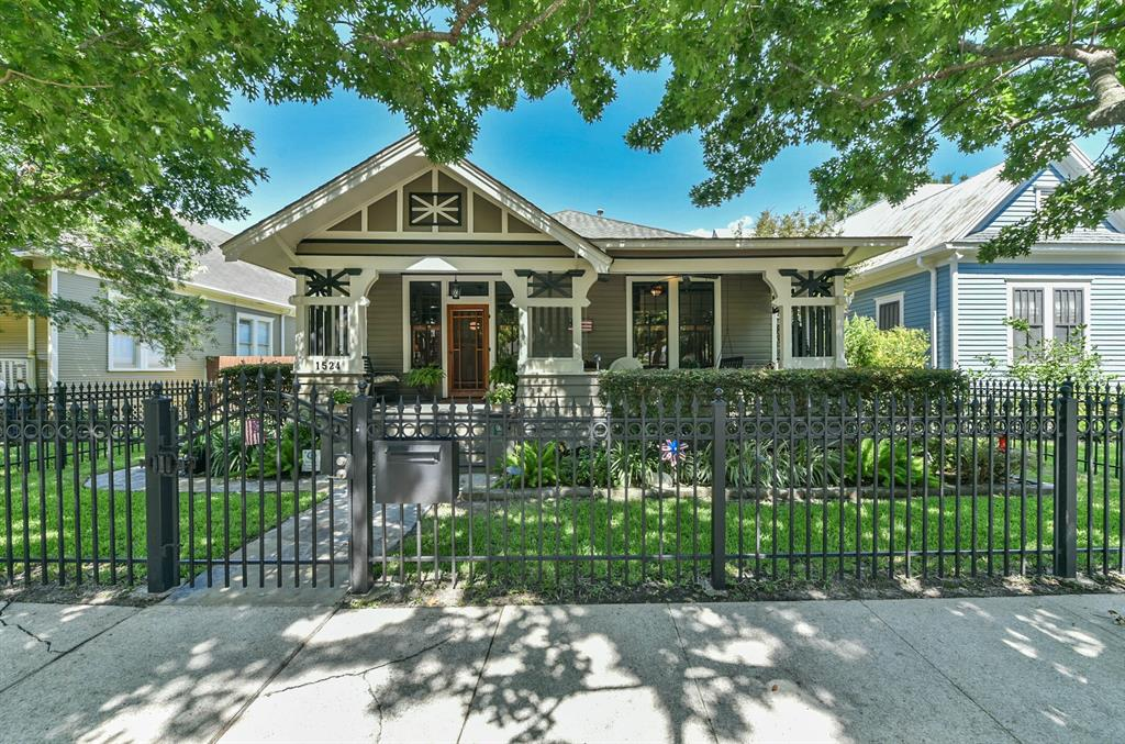Beautifully restored 1915 craftsman style gem located in the heart of the historic district. Amazing architectural attention to detail and award winner throughout the years. Original pine hardwood flooring. Exposed ceiling beams and moldings bring out the 1900's charm. Chefs dream kitchen with sleek high-end appliances, pot filler, custom cabinetry, quartz countertops with subway glass tile backsplash, wine fridge and Thermador gas range and vent hood. Spacious master suite featuring custom built in's, large his and hers closet and walk-out to the porch.  Spa-like master bath with soaking tub, walk-in shower with double heads, double sinks, and unique tiled floors. Relax on the fully screened in porch while overlooking the lush landscaping. Two car detached garage with tons of storage above. Come take a look and be a part of Houston's history.