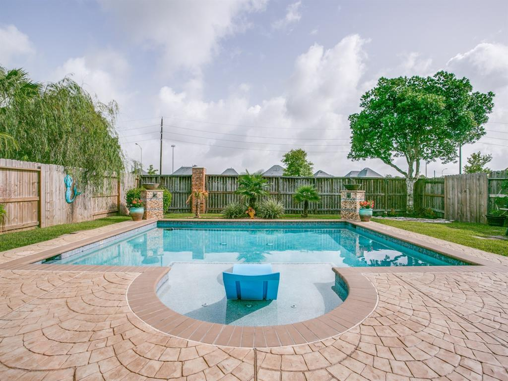 """PARADISE FOUND! Spectacular Upscale Home - Mega Updates & Backyard Paradise w/High Quality Pool, Water & Fire Features, Outdoor Fireplace & Huge Patterned Concrete Deck 2016! New Carpet Upstairs 2020, New Roof 2019, Primary & Second Bath Updated w/Granite, Vessel Sinks & More 2019, Handsome Wide Plank Floors 2016. Charming Brick Patio Welcomes you to Dramatic 2-Story Foyer, flanked by Gorgeous Dining Rm & Striking Staircase w/Iron Railing & Balcony. Arched Doorways Lead to Family Rm, Breakfast & Kitchen which Overlook  Pool. Granite Kitchen boasts 42""""Cabinets, Large Serving Bar, Loads of Storage,Pantry. Elegant Primary Bedroom Overlooks Pool & has High Ceilings, Wide Plank Floors & En-suite Spa Bath. Huge Game Room/Media, 3 Bedrooms, Landing/Study Area & Bath Upstairs. Enjoy Bonbrook Recreation Center, Pools,Splash Park,Picnic Pavilions, Playground, Soccer Field, Basketball & Volleyball Courts & Lakes. Close to Shopping, Dining, Entertainment & Highly Acclaimed Lamar Consolidated ISD."""