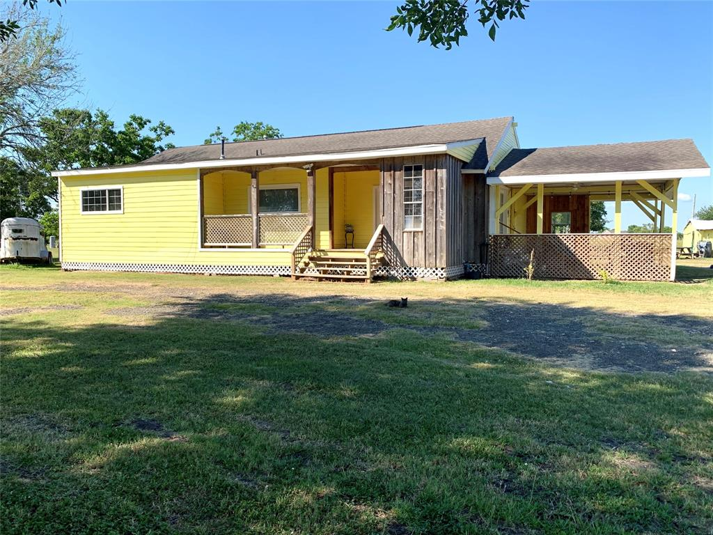 QUIET COUNTY LIVING that is only 18 minutes from Sugarland. This 4 bedrooms 2 & a half bath home sits on 5 acres. New aerobics system 2020, recent water well 4 in(260' deep, CLEAR DRINKING WATER), roof 12 yrs old, water heater 2 yrs old, re-leveled 2018. The entire ranch is secured with Stay Tuff fencing. Property has separate fenced backyard, custom dog house. Backyard overlooks the beautiful pond and pasture. Livestock barn has 3 stalls, tack room, chicken coop, and hog pen. Workshop (man cave) has radiant barrier ceiling, built in work shelves, urinal, a/c & heat.Water and Electricity are in both barn and shop.Enjoy electric gate entering the property for privacy. The driveway has been hard packed. RV hookup with 30 Amp power to accommodate visiting friends and family or use for additional rental space. Original hardwood floors, HVAC needs a new coil but runs good. Home has great closet space and old charm. home did not flood during Harvey. Great views from patio. Home needs TLC.