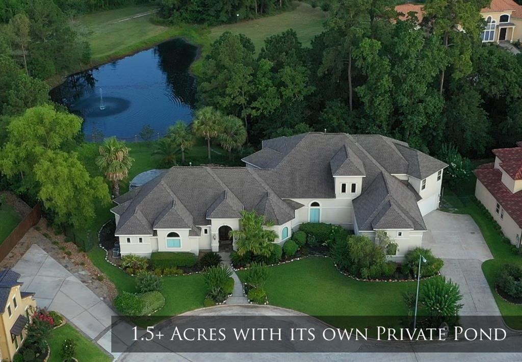 """Best kept secret in town until now. Situated on a cul-de-sac lot with 1.5+ of rolling acres, pristine landscaping, lagoon finish pool & spa, and your own fresh water private pond. With breathtaking views, serenity, privacy, & an abundance of outdoor adventures right at your doorstep, you'll never want to leave home.Designed by renowned architect, Gary Keith Jackson & built by one of Houston's finest builders, Aaron Gabay.Enjoy wildlife, direct access to 10+miles of trails, & fishing all year long in your private stocked pond. A perfect blend of luxury living and an active outdoor lifestyle, this home is an entertainer's dream. The outdoor oasis features a 1200 sq.ft. covered Veranda, Lanai, fully equipped outdoor kitchen, & there's even an outside shower.The craftsmanship of the interior is exquisite w/ 12' and 14' ceilings, 8"""" baseboards, solid core doors, designer triple painted cabinets, over-sized 4 car garage, & so much more. House&pool is located outside of 500yr floodplain."""