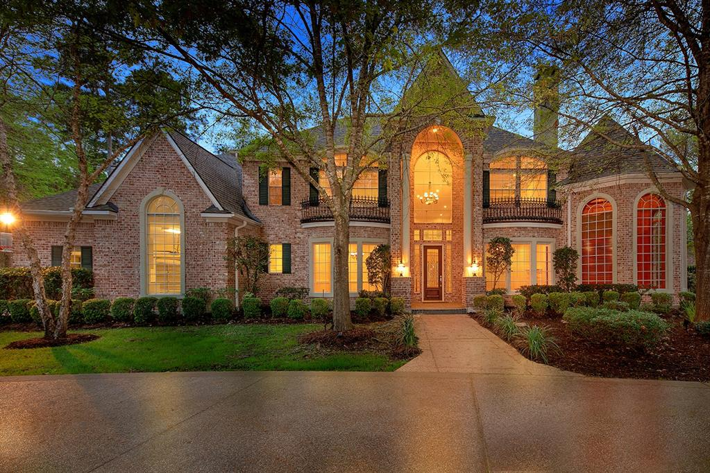 Spectacular Ultra Classic custom home overlooking the Palmer Golf Course in Cochran's Crossing! Located on an impressive 3/4 acre lot, this home features a circular drive, 4 car attached garage, grand 2 story entry, detailed trim work, abundant windows with golf course views and stunning finishes throughout. Open and airy island kitchen with granite counters, breakfast bar and stainless steel appliances overlooks breakfast room and den with gas log fireplace; both formals; wood paneled study with built-in desk and French doors; master retreat and 2nd bedroom down; 4 bedrooms and game room up; huge fenced yard with covered patio, beautiful pool, spa, outdoor kitchen and multiple seating areas overlooks the serene golf course.