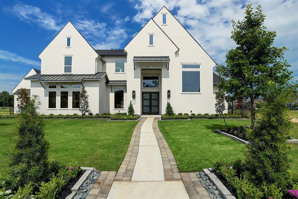 Beautiful custom home built by PARTNERS IN BUILDING, situated on a WATERFRONT lot in the prestigious gated section of Prosper in Stillwater. This home is loaded with options and includes 5 Bedrooms (2 down), a Game Room and Media room!  Light and Bright design with beautiful décor and stunning elevation.  Come and See!  Highly acclaimed Woodlands schools, super easy access to I-45!