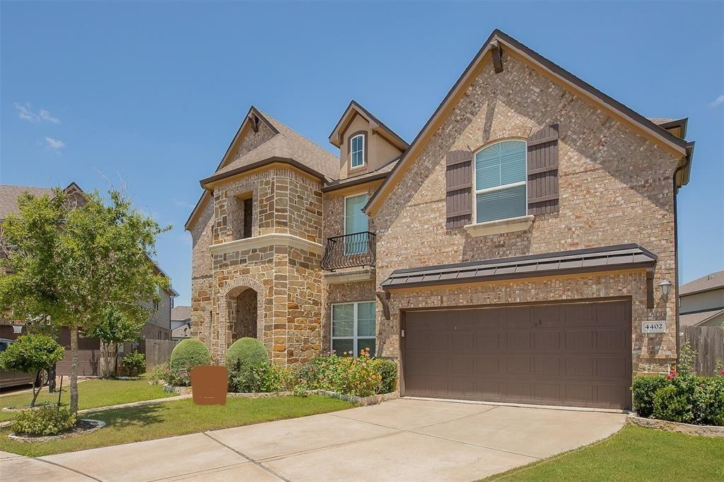 This gorgeous home with brick and stone exterior offers an open floor plan with an abundance of natural light. Enjoy breakfast with windows overlooking an enormous backyard. Living space is open to the kitchen with white and gray marbled tile floors,upgraded granite, double sink, fireplace with beautiful backsplash, and butler's pantry. Great for entertaining! Large covered patio with gas and water access for outdoor entertainment. Downstairs you will find the master suite with a built-in sitting bay for relaxation, master bath with pebbled floor shower and soaking bathtub, and spacious closet.  you will also find media room with carpet as you enter the house with study room on your left side. Upstairs you will find a large game room and three bedrooms. 1st and 2nd floor has wood, 1st floors starts with white tiles and then wood onwards. This stunning home has it all!