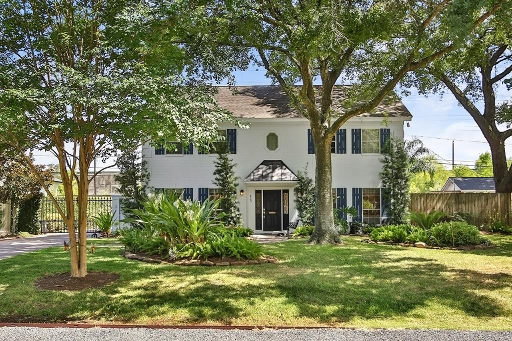 Beautiful Garden Oaks home on a large lot, draped by mature trees, just steps from the park and restaurants! Remodeled kitchen features stainless appliances, a large 9'X4' island that opens to the family room. The cozy Austin stone fireplace has a reclaimed wood mantle. Glass doors lead out to the covered patio and fabulous pool. The formal dining room can also be used as a study. A secondary bedroom with an ensuite bath is on the first level. The primary and 2 bedrooms are located on the second floor. The focal points of the huge primary suite are a fireplace. and breathtaking wall of windows in the adjacent sitting room that overlooks the pool. The large laundry room has a sink, space for beverage cooler, and storage closet. The bonus game room can also be the 5th bedroom. 3 car garage with epoxied floor, utility sink, has a pony wall of lockers for sporting equipment that sections off the 3rd bay. Long paved driveway for extra parking as well as a front parking pad at the street.