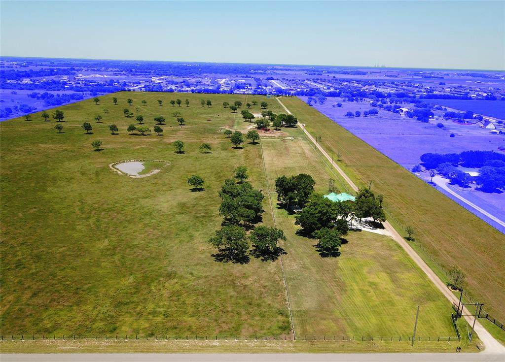 Idyllic farm/ranch in Needville. 70+ acres, pond and 2 newly remodeled homes, plus new fencing around property. Both homes have new electric, plumbing, ac and septic. Larger front home has new metal roof and tile throughout. Each bedroom has its own en-suite. With new residential/commercial coming into the area, land value will continue to increase!