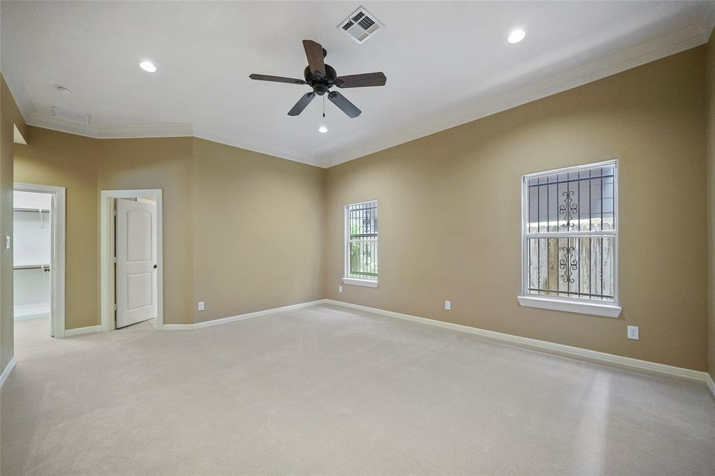 The primary bedroom also includes recessed lighting, crown molding, and a great walk-in closet.