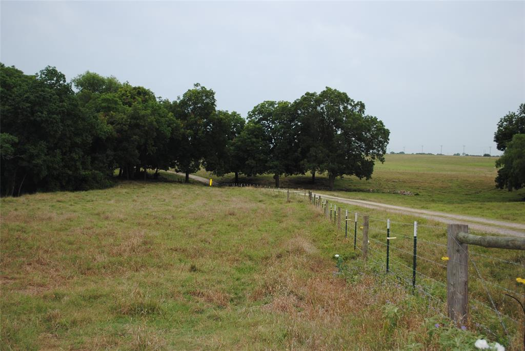 Beautifiul rolling +/- 15.55 acres very close to the heart of Brenham - yet still quiet and peaceful. The land features a nice hilltop with a perfect building spot. The hillside slopes down to a pretty seasonal creek. The creek is lined with huge 100 year old pecan and oak trees. Beautiful views and ag exemption in place.