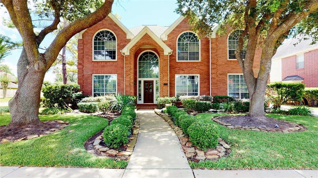 Zoned to Excellent Schools, this 5 bedroom, 3.5 bath, with pool & spa is ideally situated on a corner lot, backing up to a nature reserve. Master bedroom on the first level with large windows look out to the backyard pool/spa and lush greenery.  Former Perry model home, many extras and built ins throughout the home.  High ceilings from the moment you open the door, hardwood floors, both formals, study and cozy fireplace.   Large, open kitchen with island, lots of cabinet space, Bosch double ovens and walk in pantry. Double stair cases to the 2nd level featuring: large game room/media and 4 additional bedrooms. Quick and easy access to shopping, restaurants, parks and entertainment! Check out the 3D virtual tour!