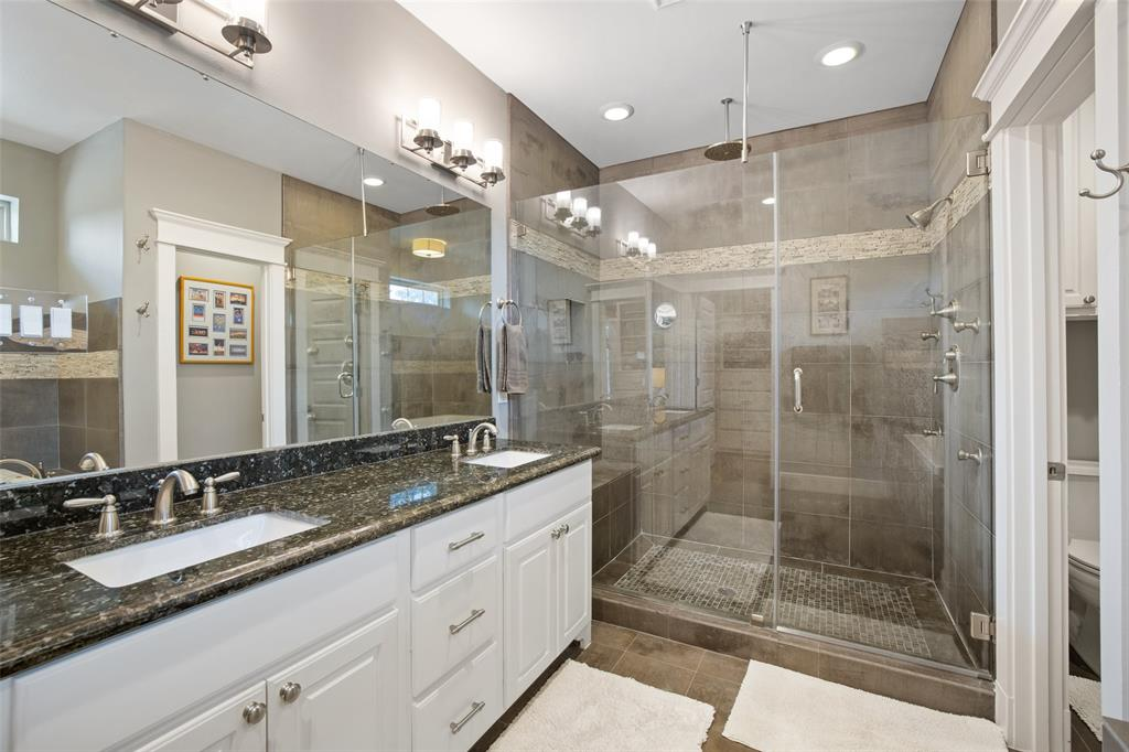 Check out this luxurious separate shower with rainfall shower head, 4 body spray heads, frameless glass shower door, a large bench, and beautiful tile shower surround. The master bath also includes double sink vanity and granite counter-tops.