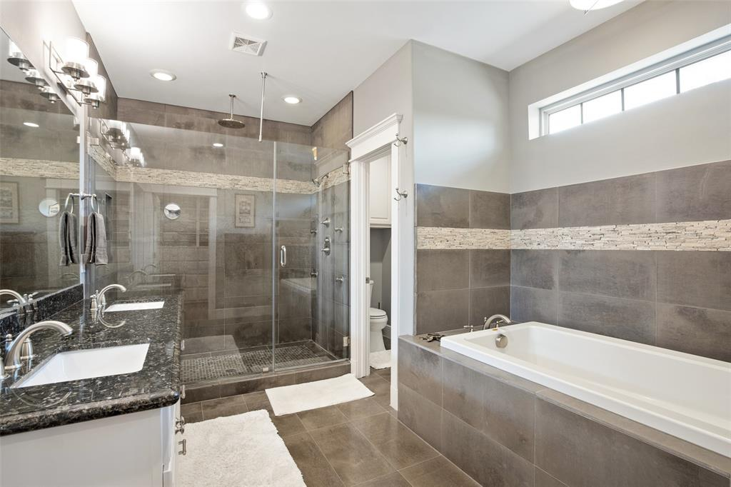 Relax in the large jetted Jacuzzi tub.