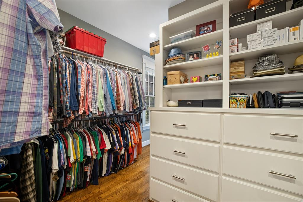 This is one of 2 large closets in the master suite. This one includes some great built-ins, including this chest of drawers and large shoe rack located just around the corner.