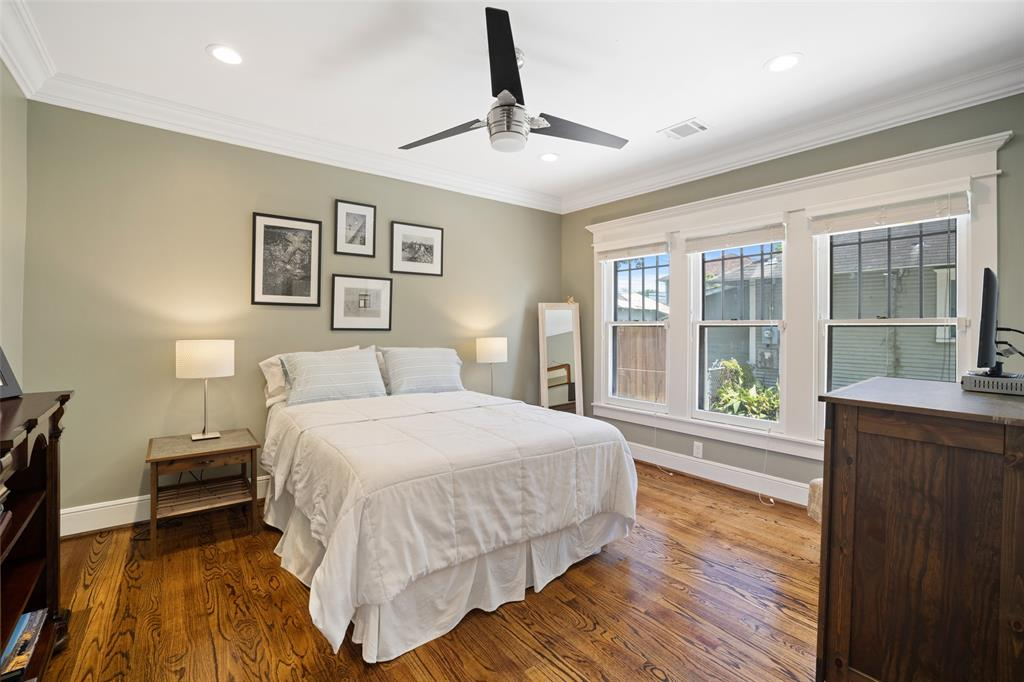 This secondary bedroom is located on the 1st floor. It includes a generous closet, hardwood floors, recessed lighting, and a ceiling fan.