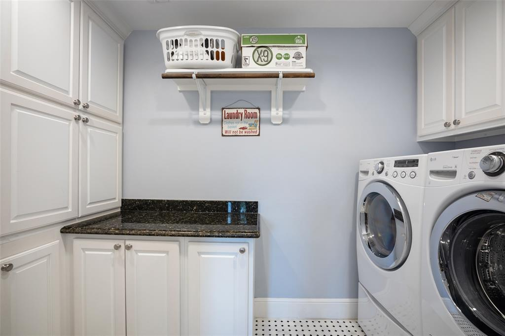 The in-house utility room includes a folding station and lots of extra storage.