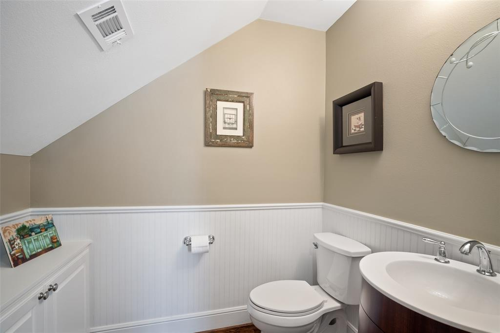This half bath is located downstairs off the family room.