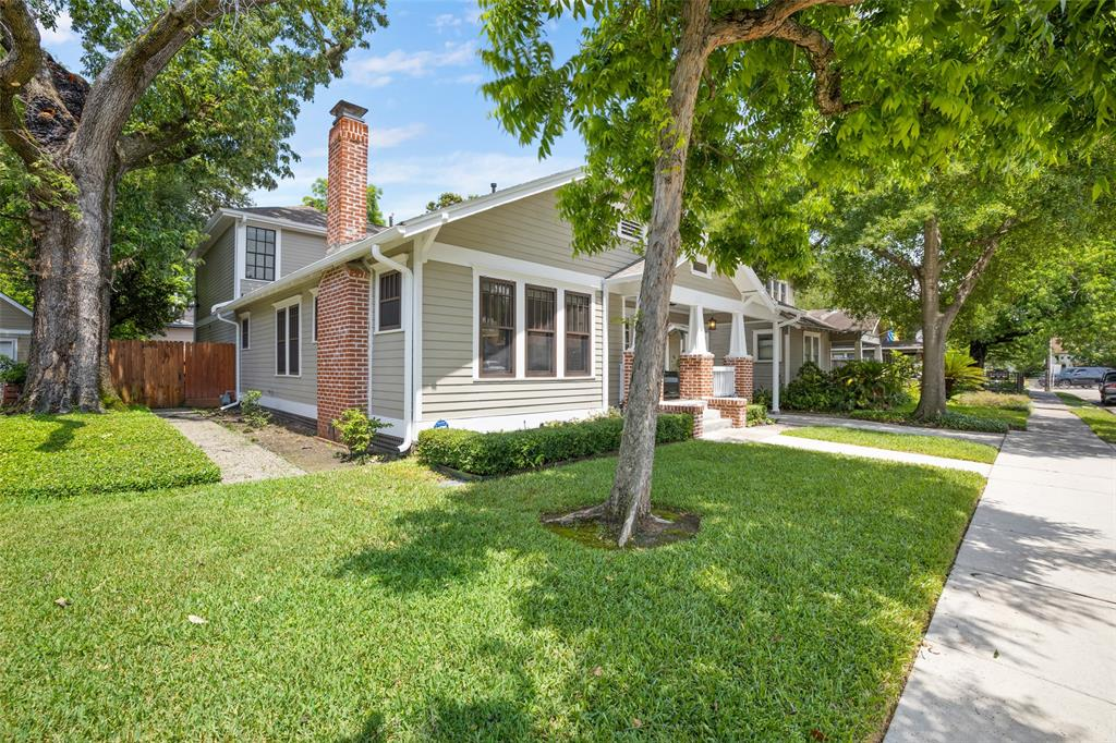 The yard and landscaping is gorgeously maintained, which includes some mature trees and sprinkler system in the front and back. Located in Norhill Heights, the streets include sidewalks and curbside parking.