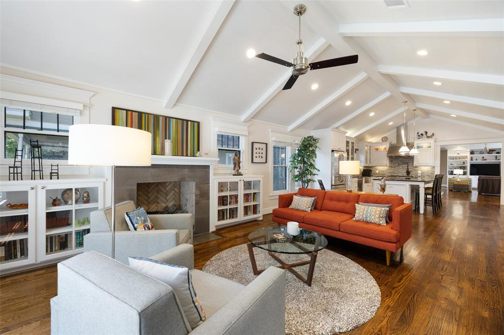 You'll love the combination of open and private space throughout this home. The front den includes a shiplap cathedral ceiling, oak floors, classic sash windows, and a fireplace with beautiful surrounding tile. All of which helps make this a great space to read a book or entertain.