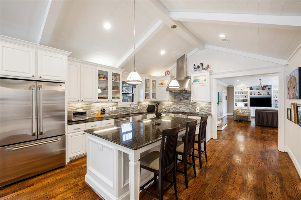Not only will you love the design of this kitchen, but you'll also love the function as well. The luxury amenities you will find include a GE Monogram 6 burner range, a large stainless steel basin sink, a pot filler, a Sharp microwave drawer, GE Monogram wine fridge, and a large pantry.