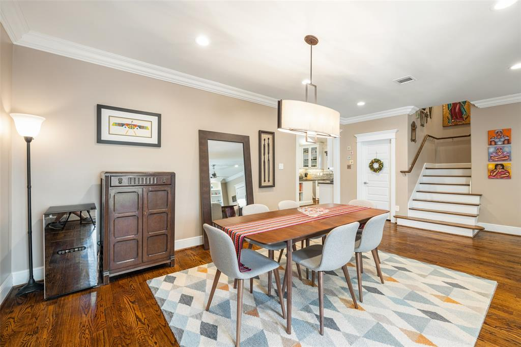 The dining space is located right off the kitchen and the living room. Like much of the house, you will find recessed lighting, crown molding, and gorgeous hardwood floors.