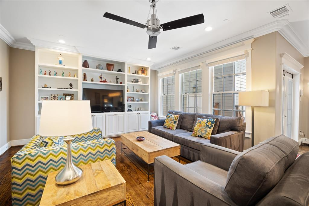 In addition to the front den, this home offers a second family room at the back of the home. This room is a great place to watch the game, binge watch a couple of shows, or simply hang out with the family. The room is wired for sound and includes custom built-ins.