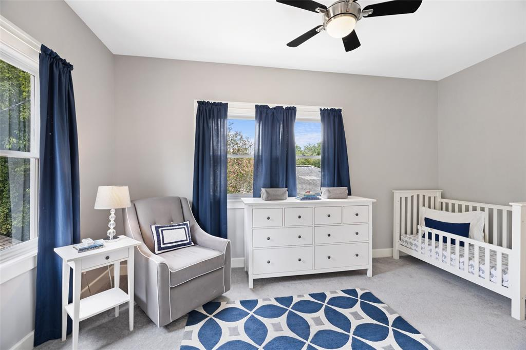 This bedroom is currently being utilized as a nursery and located upstairs off the primary bedroom suite.
