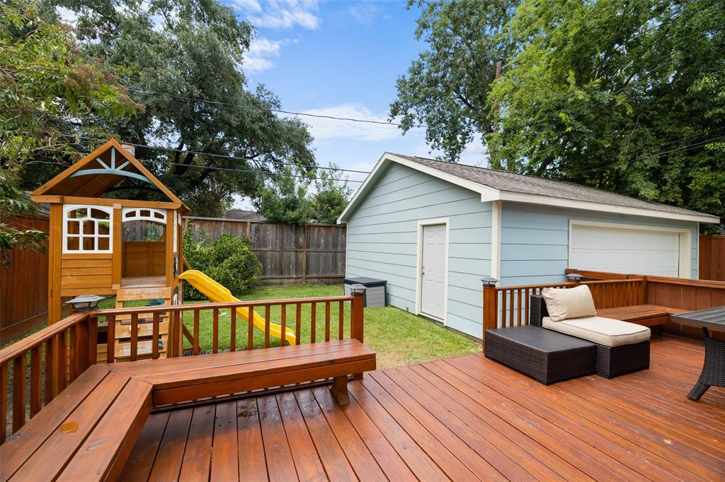 Per the seller, the back porch has recently been refinished. With built-in seating, this porch area makes a great space to entertain.