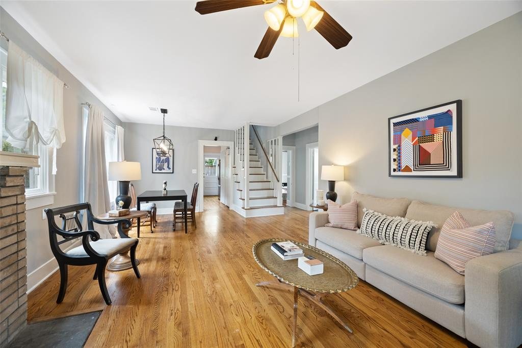 Main living space is open to the dining room.  It includes hard wood floors and lots of natural light.