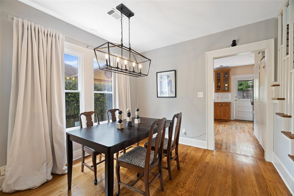 Dining room space includes chandelier and great natural light.