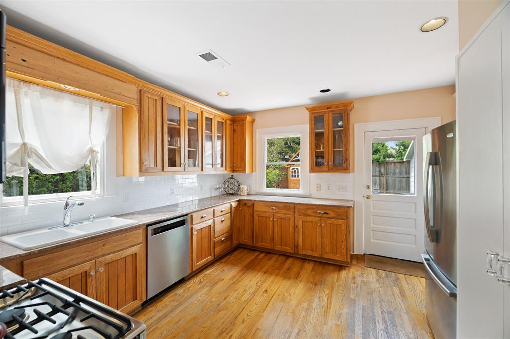 The chef in your family will love this spacious farmhouse style kitchen with its great storage and generous counterspace.
