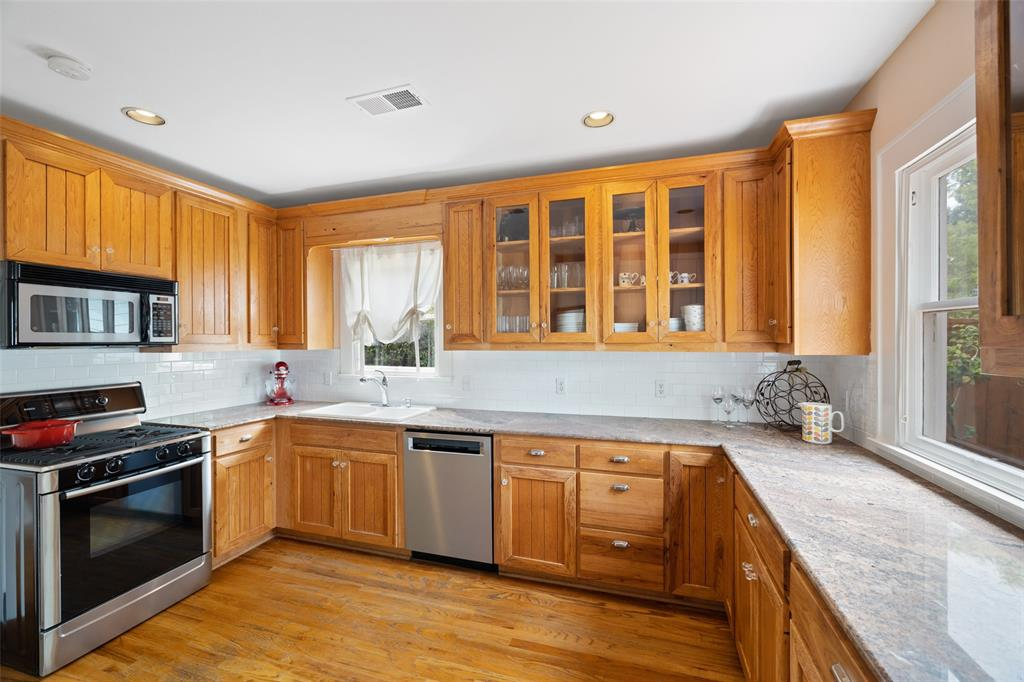 Kitchen also includes stainless steel appliance, recessed lighting, gorgeous countertops and classic subway tile backsplash.