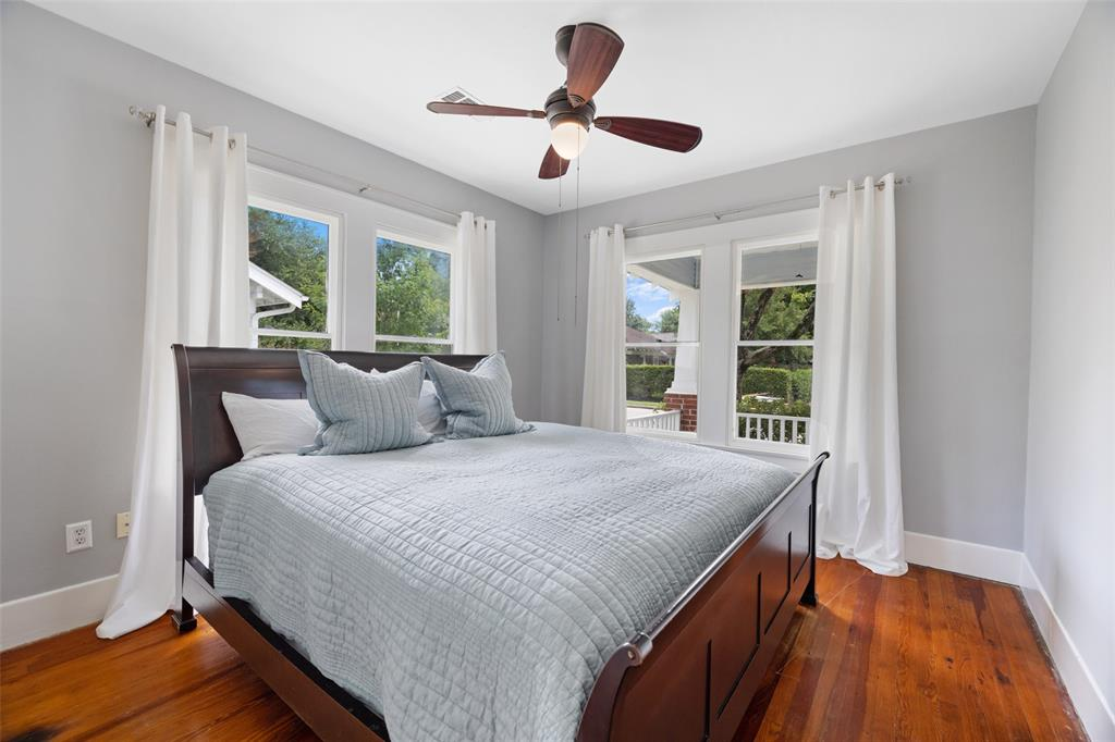 This home includes 4 bedrooms. This downstairs bedroom includes hardwood floors and lots of natural light.